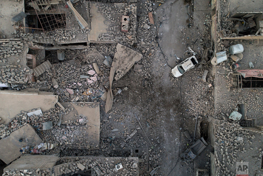 In this July 13, 2017 photo, aerial view of a destroyed street in the west side of Mosul, Iraq. (AP Photo/Felipe Dana)
