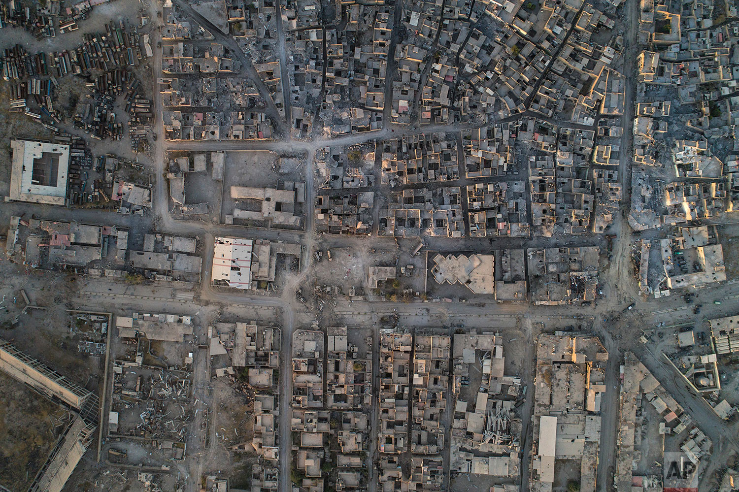 In this June 29, 2017 photo, aerial view of damaged buildings in the Old City of Mosul, Iraq. (AP Photo/Felipe Dana)