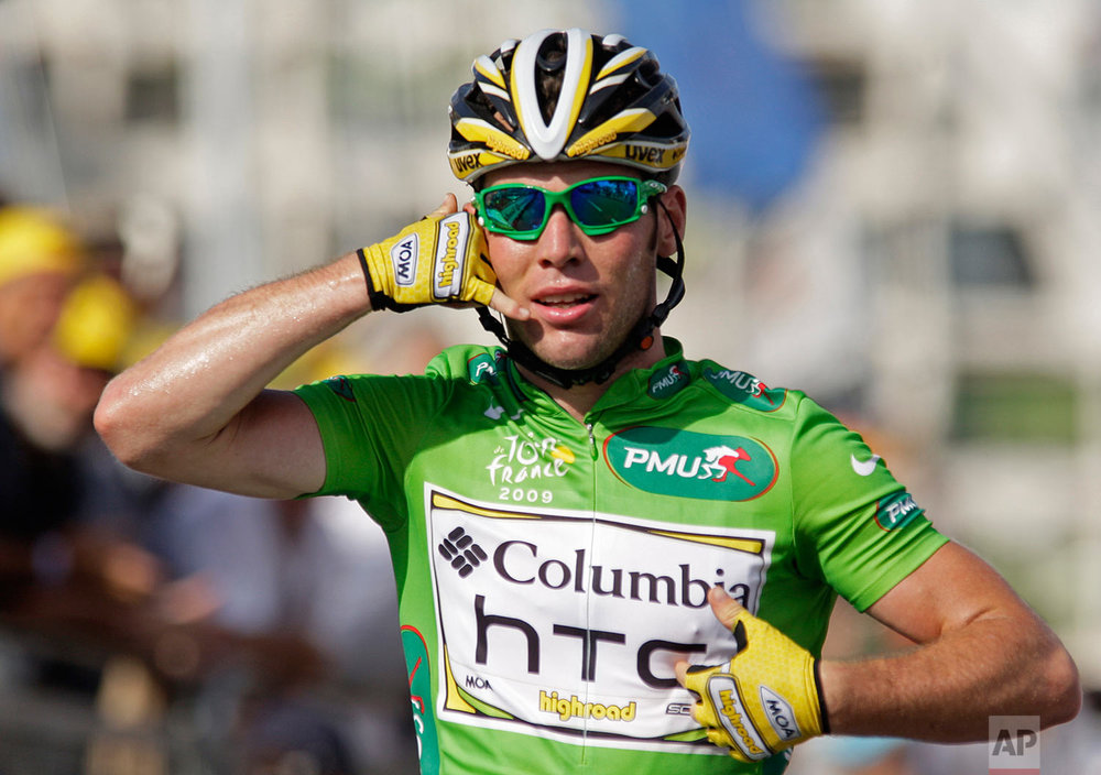 Mark Cavendish of Britain, wearing the best sprinter's green jersey, reacts as he crosses the finish line to win the third stage of the Tour de France cycling race over 196.5 kilometers (122 miles) with start in Marseille and finish in La Grande-Motte, southern France, Monday July 6, 2009.  (AP Photo/Bas Czerwinski)