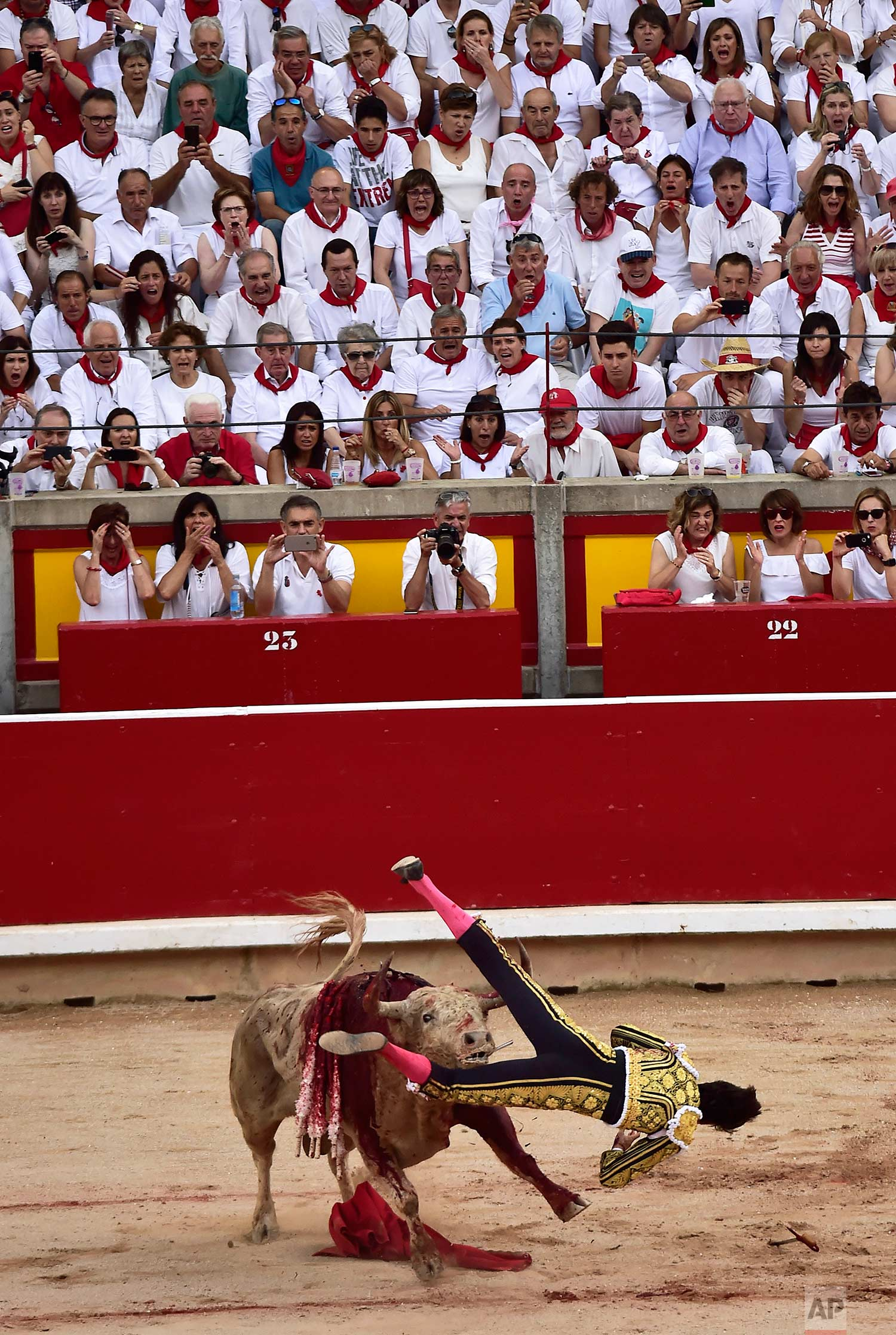 Spanish bullfighter Roca Rey is upended by a bull from the Jandilla ranch during a bullfight at the San Fermin Fiestas in Pamplona, Spain, Tuesday July 11, 2017. (AP Photo/Alvaro Barrientos)
