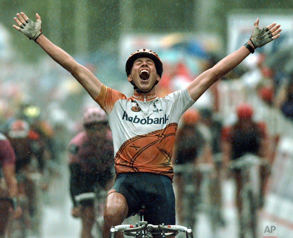 Michael Boogerd of the Netherlands reacts as he crosses the finish line to win the sixth stage of the Tour de France cycling race between Arc-et-Senans and Aix-les-Bains, eastern France Friday July 5, 1996. (AP Photo/Laurent Rebours)