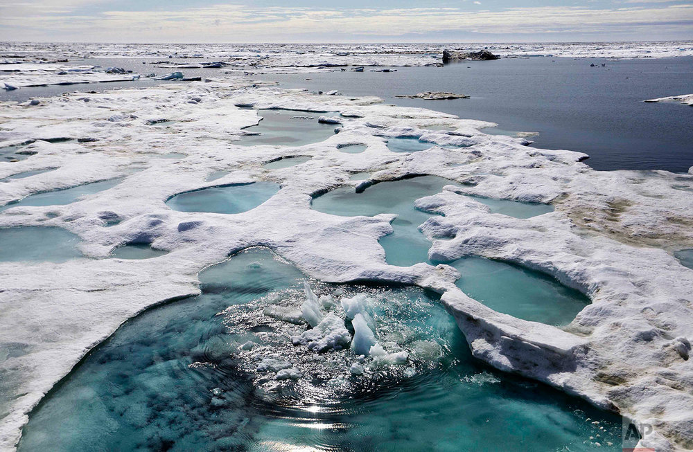Ice is broken up by the passing of the Finnish icebreaker MSV Nordica as it sails through the Beaufort Sea off the coast of Alaska while traversing the Arctic's Northwest Passage, Sunday, July 16, 2017. The region has become a magnet for nations wanting to exploit the Arctic's rich oil reserves and other natural resources and for scientists seeking to understand global warming and its impacts on the sea and wildlife. (AP Photo/David Goldman)