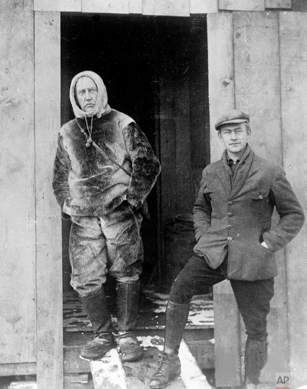 Norwegian explorer Roald Amundsen, left, stands with Lieutenant Undahl, who is his pilot in the attempt to fly over the North Pole, at the doorway to his hut on the Arctic ice in 1926. In 1911 Amundsen beat Captain Robert Scott to be the first man to reach the South Pole. (AP Photo)