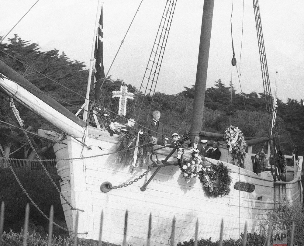 Memorial services for Roald Amundsen, famous explorer, at the land anchorage of his former ship, the Gjoa, in Golden Gate Park, San Francisco Dec. 14, 1928. Amundsen sailed the Gjoa through the Northwest Passage in 1903, a voyage that took three years to accomplish. The speaker is O.T. Brandrud, Pastor of the Trinity Lutheran Church of Oakland. Norwegian singers are in the background. (AP Photo)