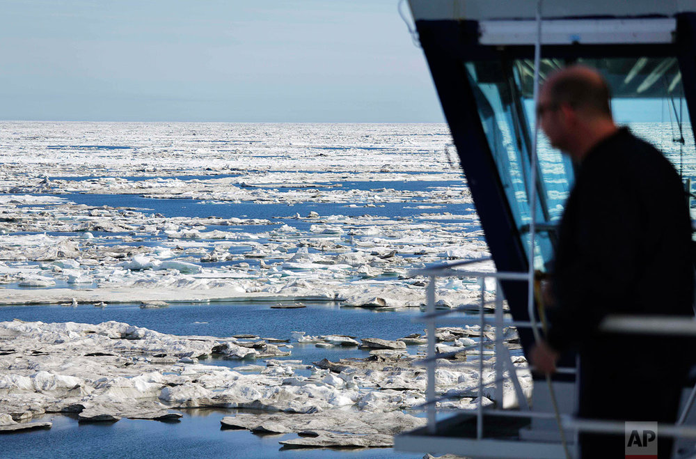 The Finnish icebreaker MSV Nordica sails through sea ice on the Beaufort Sea while traversing the Arctic's Northwest Passage, Sunday, July 16, 2017. (AP Photo/David Goldman)