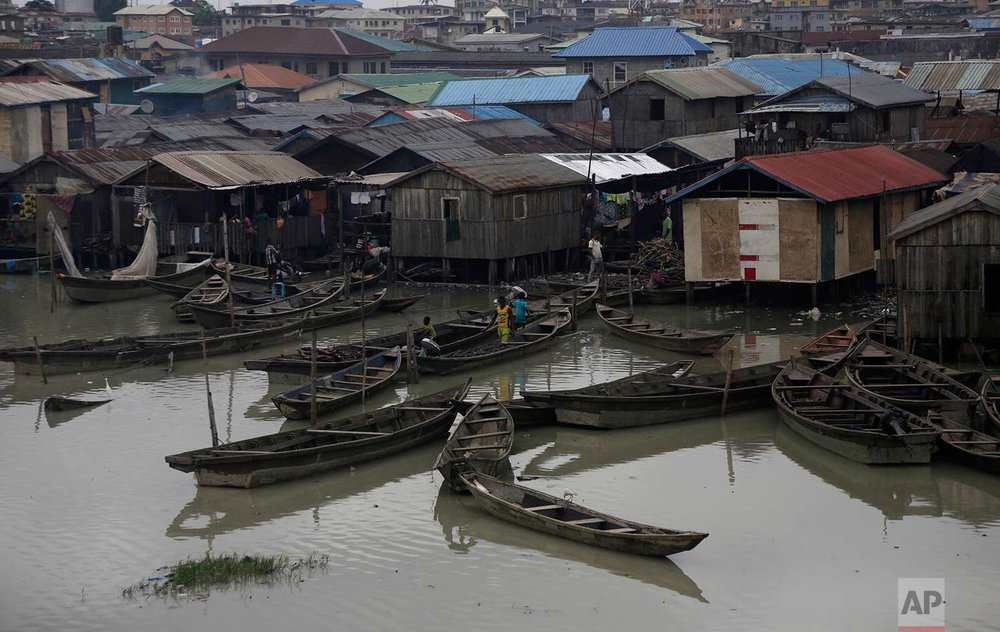 Children play aboard a fishing canoe on the waterfront of the Makoko neighborhood in Lagos, Nigeria, Thursday, July 20, 2017.  (AP Photo/Sunday Alamba)
