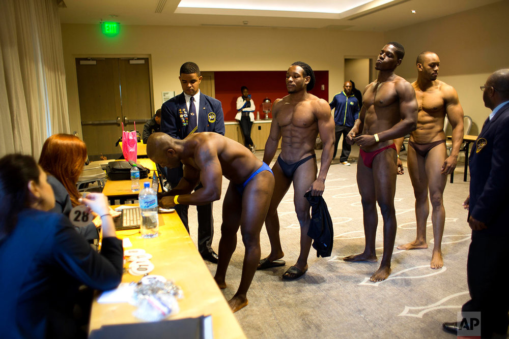 In this July 23, 2017 photo, Haitian bodybuilders register to compete in a bodybuilding competition between Haiti and Dominican Republic in Port-au-Prince, Haiti. (AP Photo/Dieu Nalio Chery)