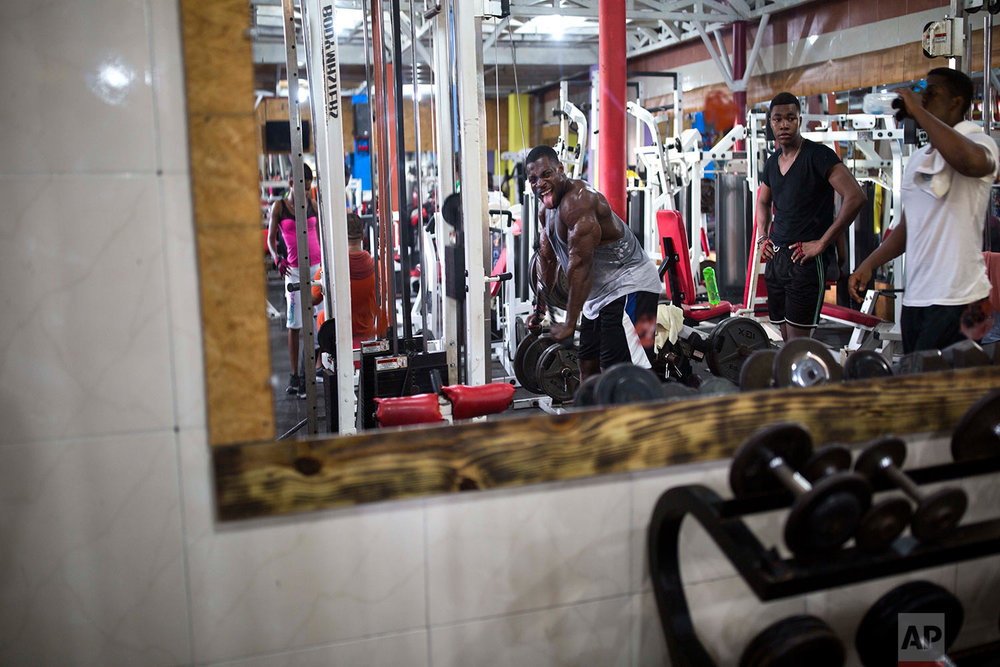 In this July 20, 2017 photo, Haitian bodybuilder Spely Laventure makes a face in the mirror as he trains for an upcoming competition in Port-au-Prince, Haiti. (AP Photo/Dieu Nalio Chery)