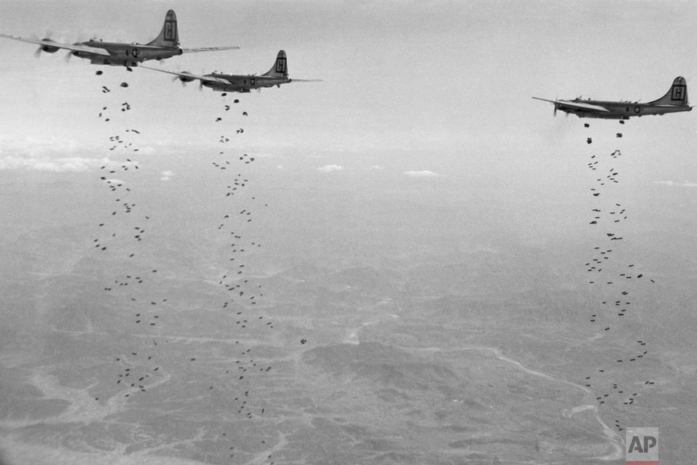 In this Jan. 18, 1951, file photo, Bomber Command planes of the U.S. Far East Air Forces rain tons of high demolition bombs in North Korea. (U.S. Air Force via AP)