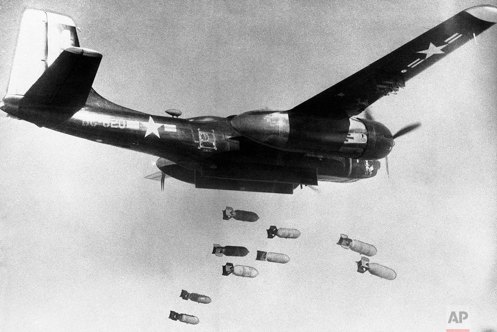 In this March 18, 1953, photo, bombs drop from a U.S. Air Force 3rd bomber wing B26 light bomber somewhere in North Korea. (U.S. Air Force via AP)