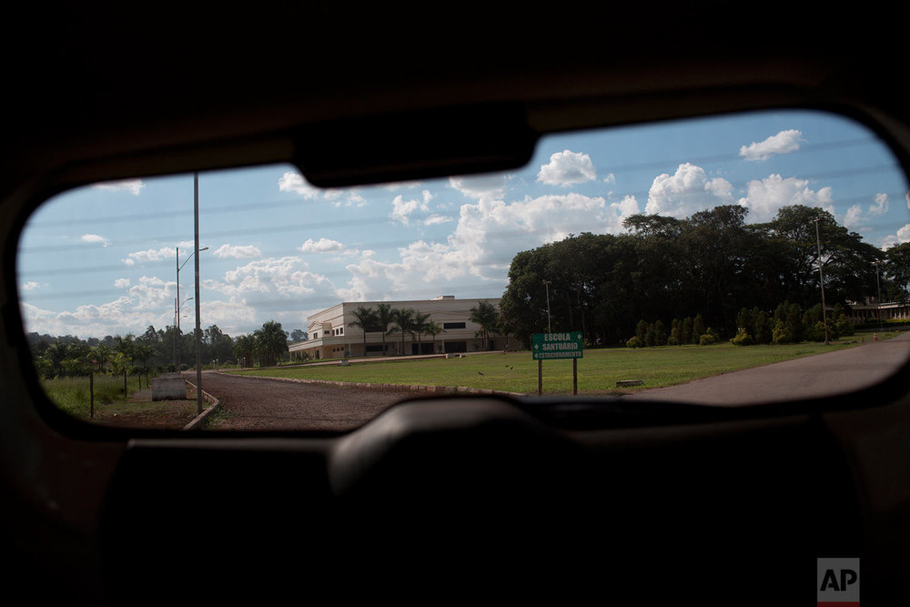 This Wednesday, March 29, 2017 photo shows the Word of Faith Fellowship church in Sao Joaquim de Bicas, Brazil, through a car window. (AP Photo/Silvia Izquierdo)