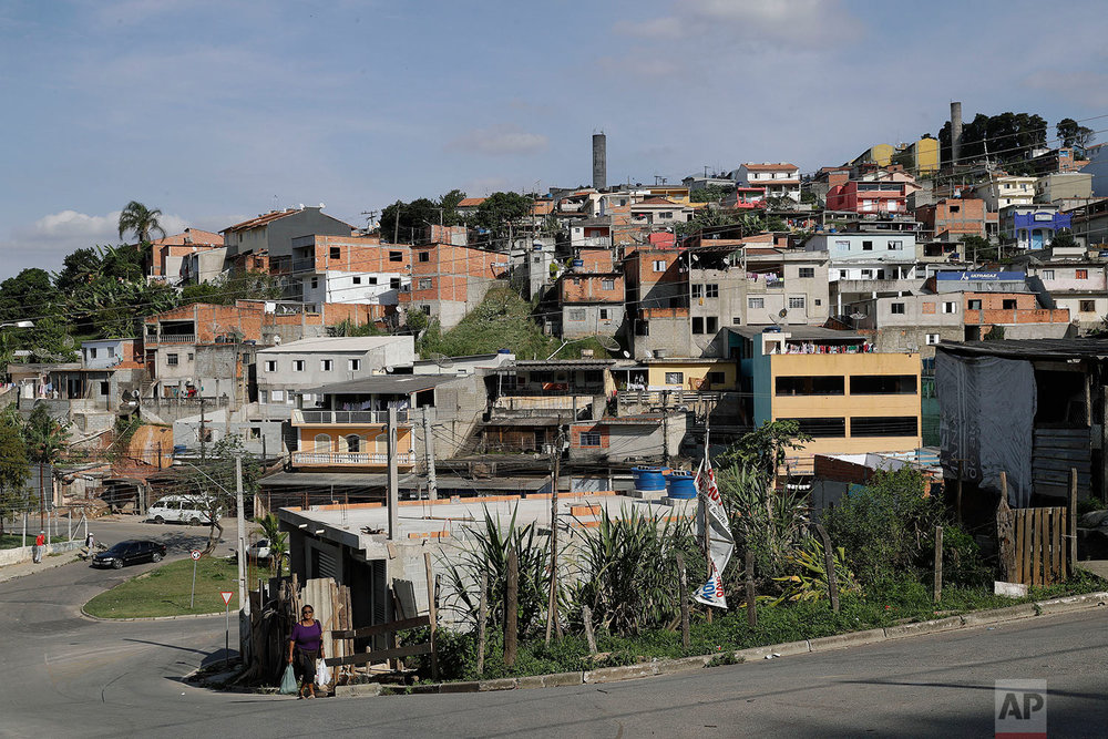 This Monday, May 29, 2017 photo shows a low-income neighborhood near the Ministerio Evangelico Comunidade Rhema, or Rhema Community Evangelical Ministry, in Franco da Rocha, Brazil, in the greater Sao Paulo area. (AP Photo/Andre Penner)