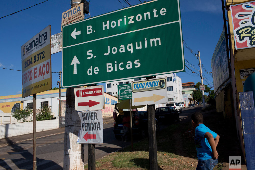 This Wednesday, March 29, 2017 photo shows a road sign pointing to Sao Joaquim de Bicas, Brazil, a small city about a 45-minute drive from Belo Horizonte. (AP Photo/Silvia Izquierdo)