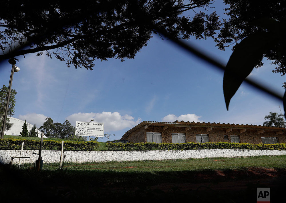 This Sunday, May 28, 2017 photo shows the Ministerio Evangelico Comunidade Rhema, or Rhema Community Evangelical Ministry, in Franco da Rocha, Brazil, in the greater Sao Paulo area. (AP Photo/Andre Penner)
