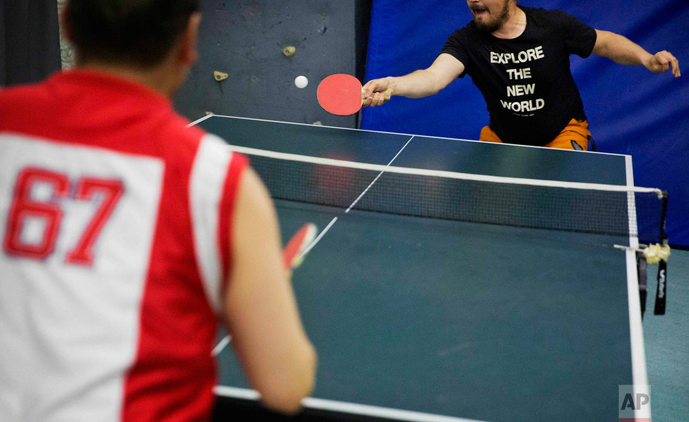 In this Saturday, July 8, 2017 photo, researcher Ari Laakso, right, plays ping pong with trainee Maatiusi Manning aboard the Finnish icebreaker MSV Nordica as it sails the North Pacific Ocean to traverse the Northwest Passage through the Canadian Arctic Archipelago. (AP Photo/David Goldman)