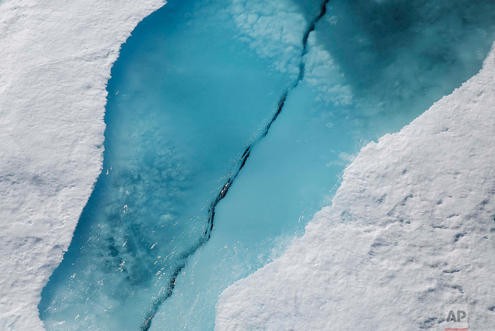 Sea ice cracks as the Finnish icebreaker MSV Nordica passes through the Victoria Strait along the Northwest Passage in the Canadian Arctic Archipelago, Friday, July 21, 2017. Sea ice helps maintain ocean and atmospheric currents that affect weather which is characteristic for certain parts of the world, such as the comparatively mild temperatures found in western Europe. (AP Photo/David Goldman)