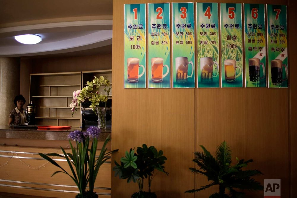 In this Wednesday, July 26, 2017, photo, a display of seven different types of Taedonggang specialty beers which ingredients comprise of different percentages of barley and white rice grains, are displayed on a wall of a beer restaurant in Pyongyang, North Korea. (AP Photo/Wong Maye-E)