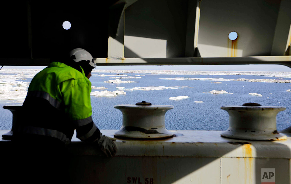 Chief engineer Jukka-Pekka Silander watches from the bow of the the Finnish icebreaker MSV Nordica as it sails into floating sea ice on the Beaufort Sea off the coast of Alaska while traversing the Arctic's Northwest Passage, Sunday, July 16, 2017. Sea ice plays an important role in the global climate system by cooling the surrounding water and air. It helps maintain ocean and atmospheric currents that affect weather which is characteristic for certain parts of the world, such as the comparatively mild temperatures found in western Europe. (AP Photo/David Goldman)