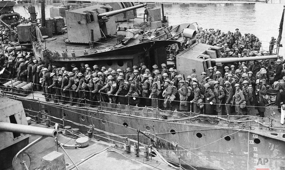 Troops of the British expeditionary force landing from a destroyer at a British port on June 1, 1940 after being evacuated, following heroic fighting, from Flanders. (AP Photo)