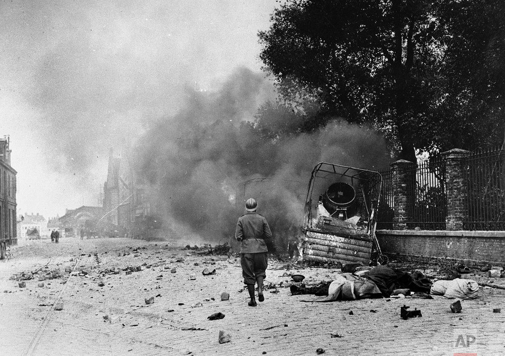Smoke and debris in a street of Dunkirk, France, showing the effects of bombardment, June 1940. (AP Photo)