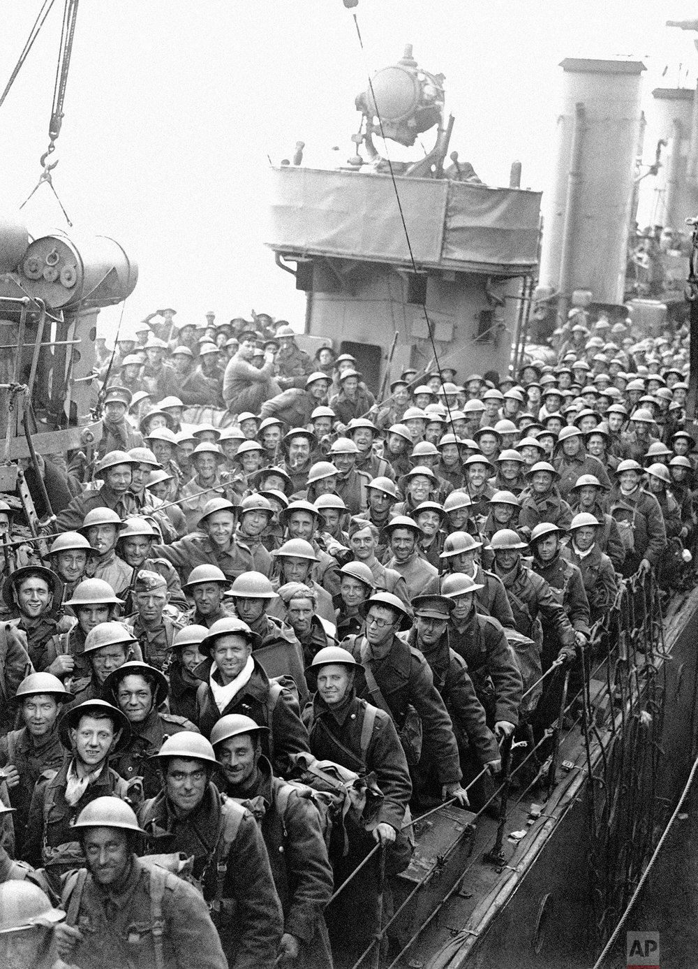 Hundreds of men of the British Expeditionary Force withdrawn from Dunkirk and Northern France are arriving back in England in a continuous stream. A destroyer's deck loaded with men of the B.E.F., May 31, 1940, somewhere in England. (AP Photo)