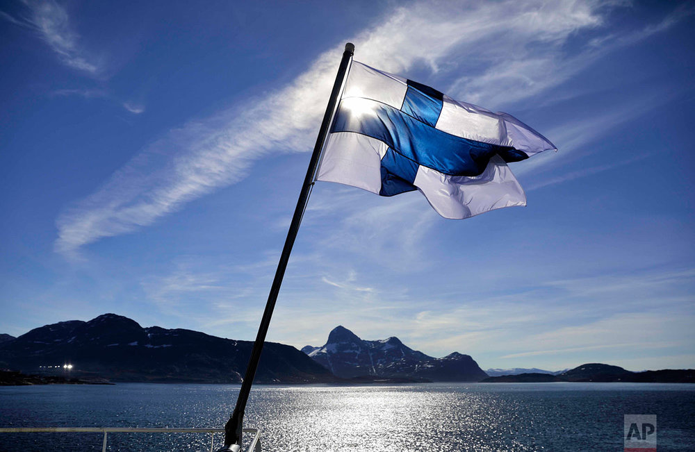 The flag of Finland flies aboard the Finnish icebreaker MSV Nordica as it arrives into Nuuk, Greenland, after traversing the Northwest Passage through the Canadian Arctic Archipelago, Saturday, July 29, 2017. After 24 days at sea and a journey spanning more than 10,000 kilometers (6,214 miles), the MSV Nordica has set a new record for the earliest transit of the fabled Northwest Passage. The once-forbidding route through the Arctic, linking the Pacific and the Atlantic oceans, has been opening up sooner and for a longer period each summer due to climate change. (AP Photo/David Goldman)