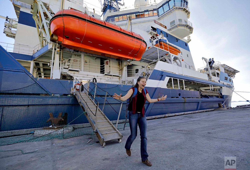 Researcher Daria Gritsenko steps onto land for the first time since setting sail aboard the Finnish icebreaker MSV Nordica as it arrives into Nuuk, Greenland, after traversing the Northwest Passage through the Canadian Arctic Archipelago, Saturday, July 29, 2017. After 24 days at sea and a journey spanning more than 10,000 kilometers (6,214 miles), the MSV Nordica has set a new record for the earliest transit of the fabled Northwest Passage. The once-forbidding route through the Arctic, linking the Pacific and the Atlantic oceans, has been opening up sooner and for a longer period each summer due to climate change. (AP Photo/David Goldman)
