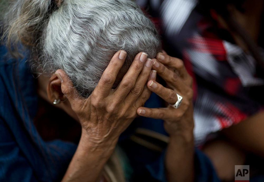 In this May 3, 2016 photo, an elderly woman waits in line outside a supermarket to buy food in Caracas, Venezuela. Nine out of 10 people said they can't buy enough to eat, according to a study by Simon Bolivar University. (AP Photo/Ariana Cubillos)