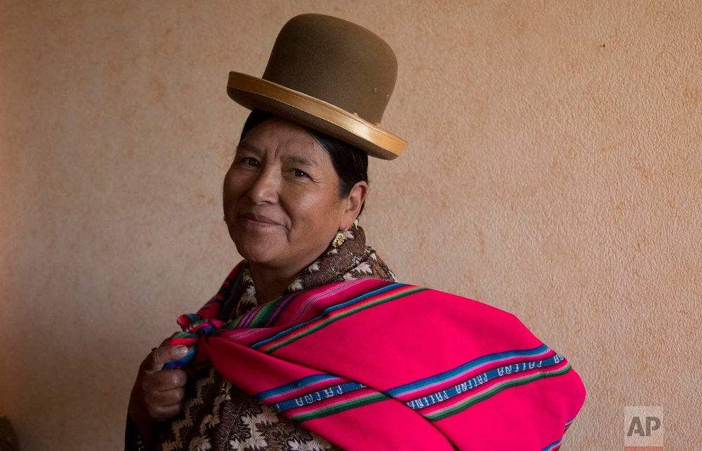 "In this July 20, 2017 photo, midwife Ana Choque poses for a portrait before leaving her home to visit a pregnant patient for pre-natal care in El Alto, Bolivia. Women from the Aymara and Quechua indigenous groups, who make up a majority of Bolivia's population, distrust hospitals and cesarean births, and prefer to rely on traditional midwives who they often refer to as ""aunt."" (AP Photo/Juan Karita)"