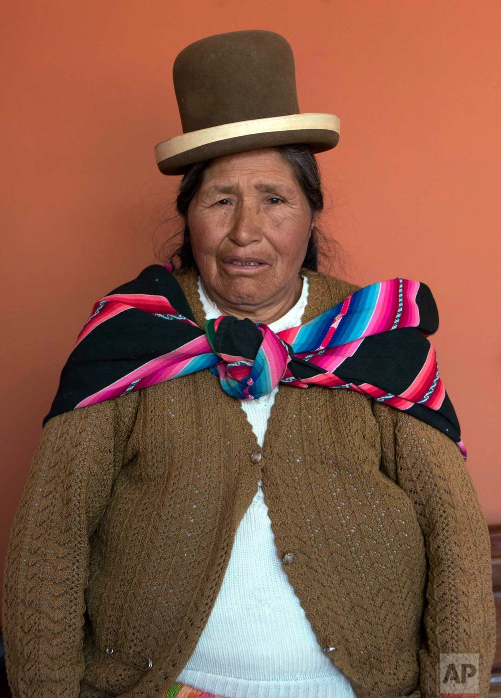 In this May 15, 2017 photo, midwife Ruperta Tola, 67, poses for a portrait at the Nila Heredia hospital in Patacamaya, Bolivia. Tola says she's been a midwife for over 40 years, starting when she was only 15 under the tutelage of her grandmother. She says people call her day and night, and sometimes to far away places in the countryside to give massages, treat broken bones, cure upset stomaches and deliver babies. (AP Photo/Juan Karita)