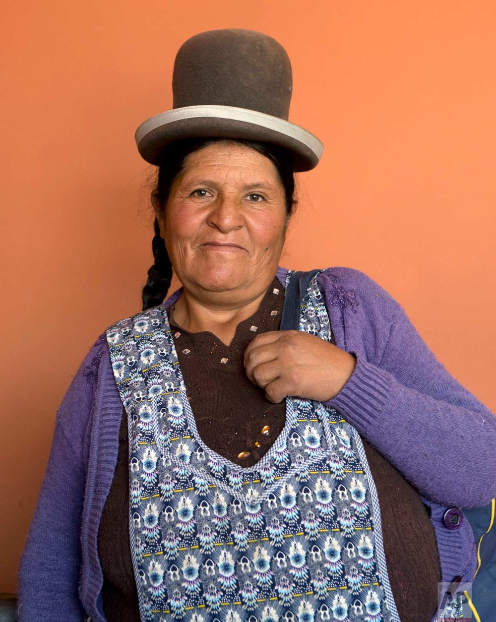 In this May 15, 2017 photo, midwife Daniela Vilca, 53, poses for a portrait at the Nila Heredia hospital in Patacamaya, Bolivia. The government's midwifery training program takes into account deeply rooted cultural traditions and the value of women who travel to distant areas that lack hospitals or doctors, according to German Mamani, Bolivia's deputy minister for traditional medicine. (AP Photo/Juan Karita)