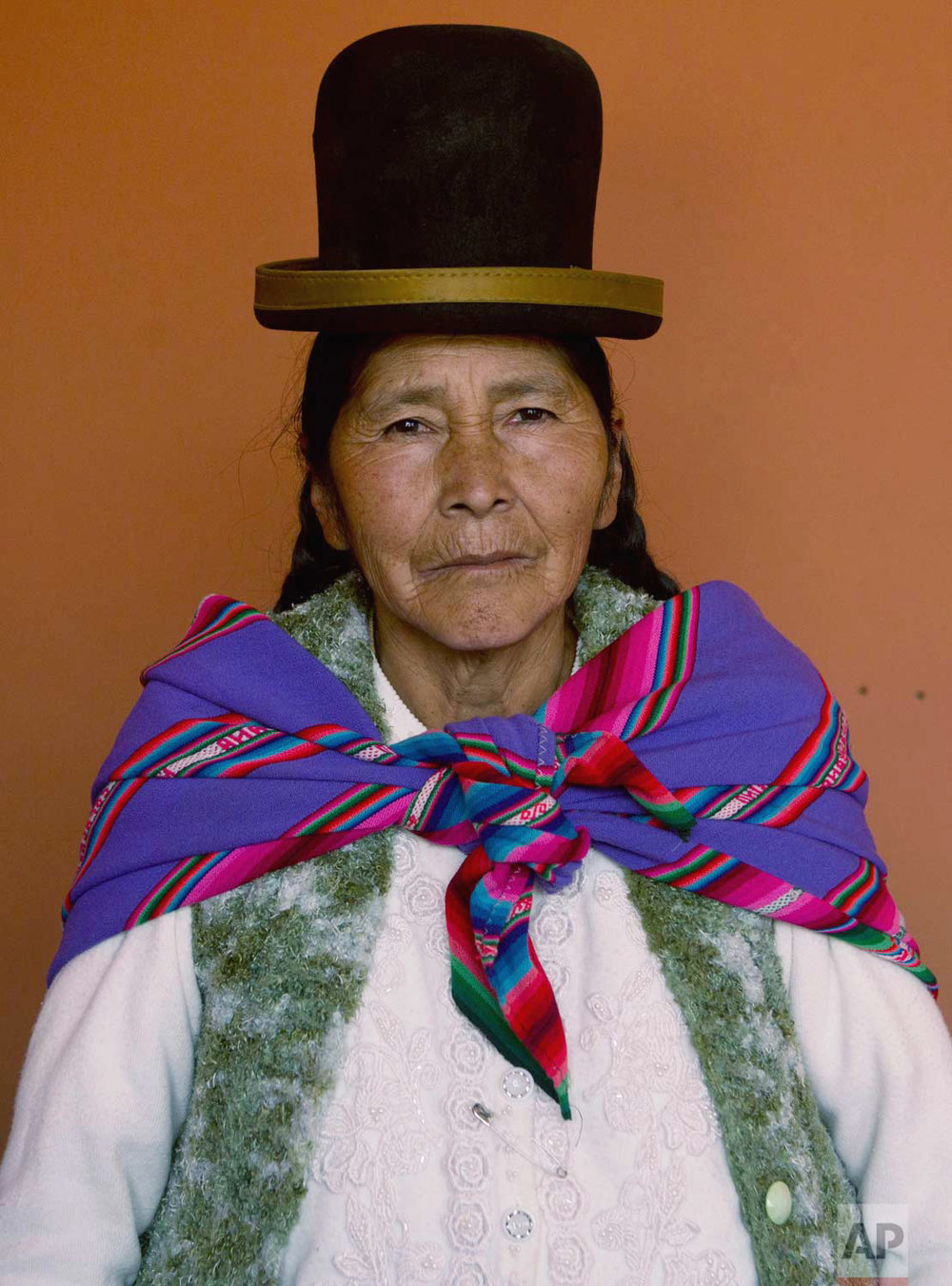 "In this May 15, 2017 photo, midwife Leonarda Quispe, 63, poses for a portrait at the Nila Heredia hospital in Patacamaya, Bolivia. Bolivia's midwife training program is partially financed by the U.N. Population Fund, which has supported similar initiatives in the Andean country. ""Women prefer us (midwives) because they're scared of the doctors,"" Quispe said. (AP Photo/Juan Karita)"