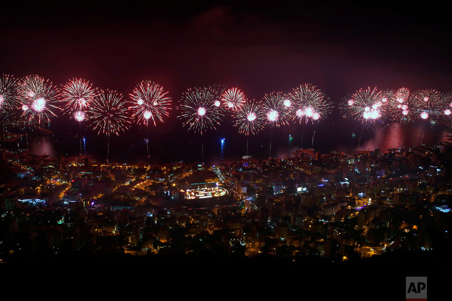 Fireworks explode over the coastal town of Jounieh, Lebanon, Saturday, July 15, 2017, during the city's international festival. The two-month annual festival includes concerts by local and international singers as well as plays and activities. (AP Photo/Bilal Hussein)