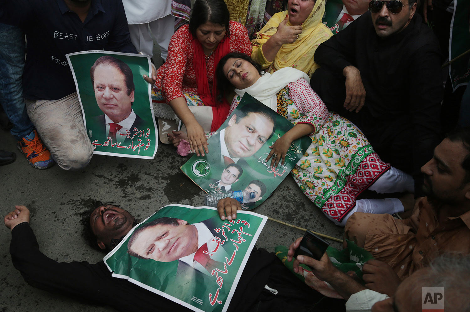 Supporters of the Pakistani ruling party Muslim League headed by Nawaz Sharif gesture during rally to condemn the dismissal of their leader in Lahore, Pakistan, Pakistan, Friday, July 28, 2017. Pakistan's Supreme Court in a unanimous decision has asked the country's anti-corruption body to file corruption charges against Sharif, his two sons and daughter for concealing their assets. (AP Photo/K.M. Chaudary)