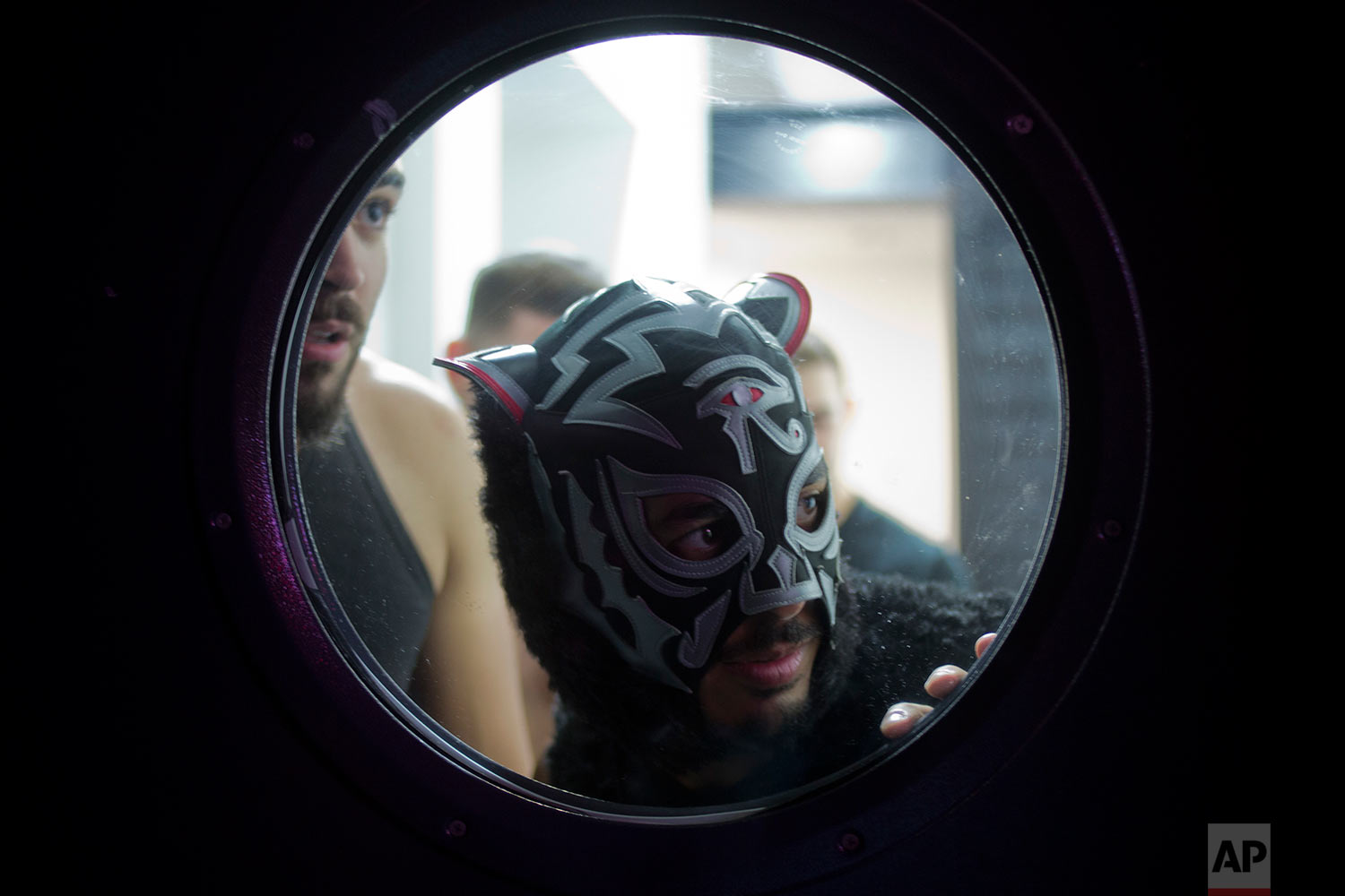 An Israeli Wrestler waits to enter the ring during The Rage Wrestling Mega Show in Tel Aviv, Israel, Sunday, July 9, 2017. (AP Photo/Ariel Schalit)