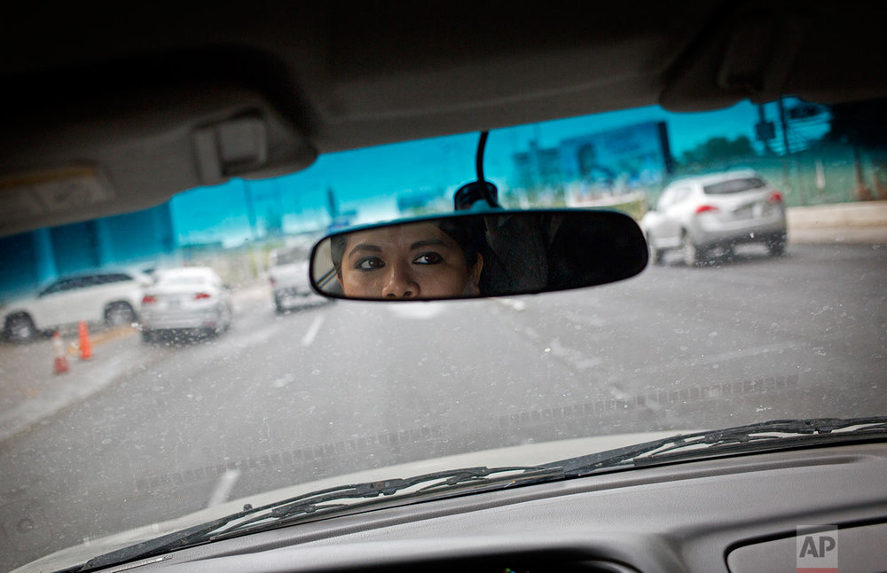 In this June 28, 2017 photo, Riodoce reporter Miriam Ramirez drives to her office in Culiacan, Sinaloa state, Mexico. After the killing of Riodoce co-founder Javier Valdez on May 15 and with an increase in killings of journalists nationwide, the newspaper's reporters are told by security experts that, among other things, it's important to change their routines, be more careful with social media and not leave colleagues alone in the office at night. (AP Photo/Enric Marti)