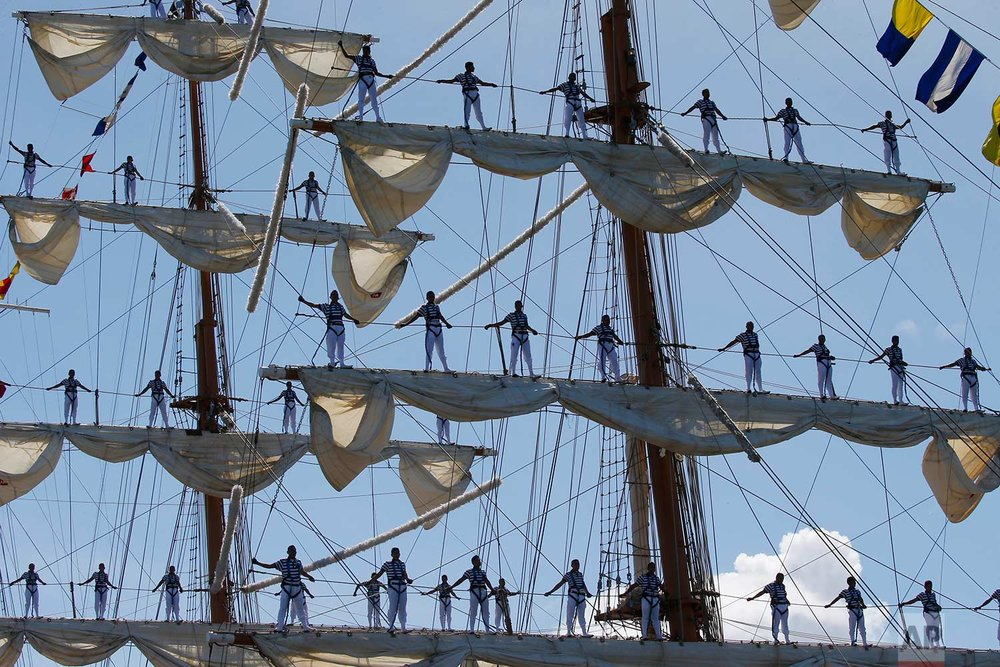 Mexican Navy crew members stand on the sails of the ARM Cuauhtemoc tall ship as it prepares to dock in the South Harbor in Manila, Philippines, for a five-day goodwill visit starting Friday, Aug. 4, 2017. (AP Photo/Bullit Marquez)