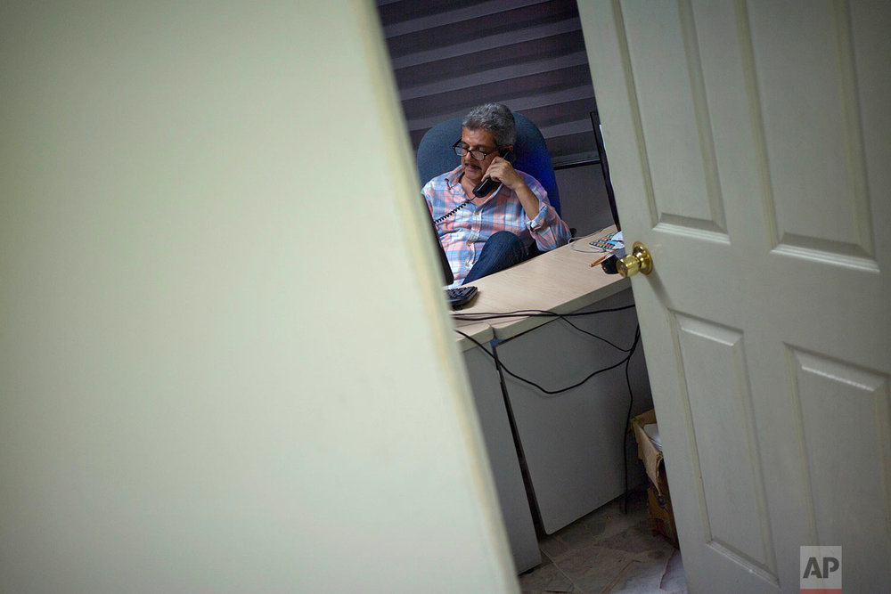 In this June 30, 2017 photo, Ismail Bojorquez, 60, co-founder and director of Riodoce, speaks on the phone as he prepares the weekly edition at his office in Culiacan, Sinaloa state, Mexico. Bojorquez and slain journalist Javier Valdez joined three colleagues in creating the newspaper Riodoce. Over time the paper earned a reputation for brave and honest coverage. (AP Photo/Enric Marti)
