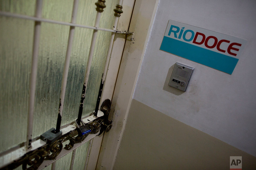 In this June 28, 2017 photo, locks cover the door of the office of Riodoce newspaper in Culiacan, Sinaloa state, Mexico. Riodoce is a weekly magazine created in 2003 that has earned over the years a reputation for brave and honest coverage. Riodoce's offices are housed in a apartment building in a middle-class neighborhood of Culiacan. (AP Photo/Enric Marti)
