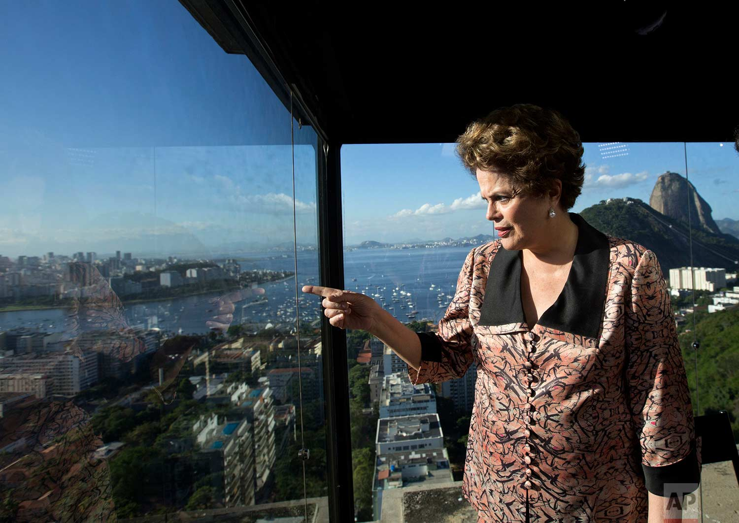 Brazil's former President Dilma Rousseff looks out over Guanabara Bay, before the start of an interview at the offices of the Associated Press in Rio de Janeiro, Brazil, Friday, July 14, 2017. (AP Photo/Silvia Izquierdo)