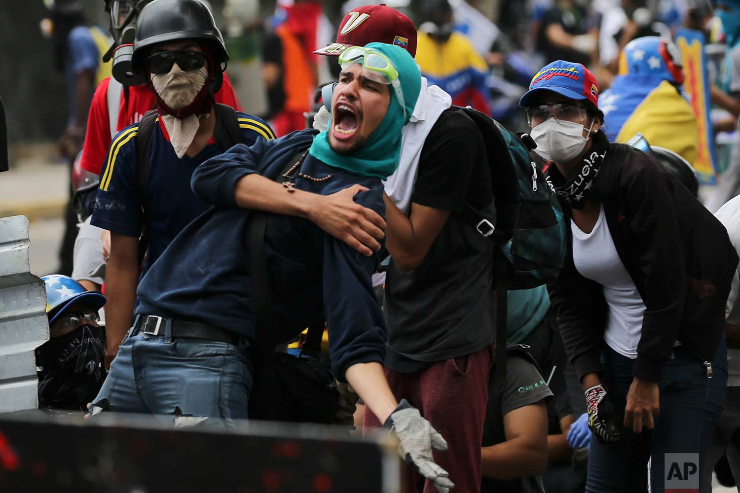 An anti-government protester screams at security forces blocking a march to the Supreme Court to oppose President Nicolas Maduro's plan to rewrite the constitution, in Caracas, Venezuela, Saturday, July 22, 2017. (AP Photo/Fernando Llano)