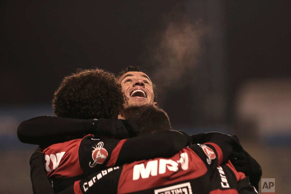 Leandro Damiao of Brazil's Flamengo celebrates with his teammates after scoring against Chile's Palestino during a Copa Sudamericana soccer match in Santiago, Chile, Wednesday, July 5, 2017. (AP Photo/Esteban Felix)