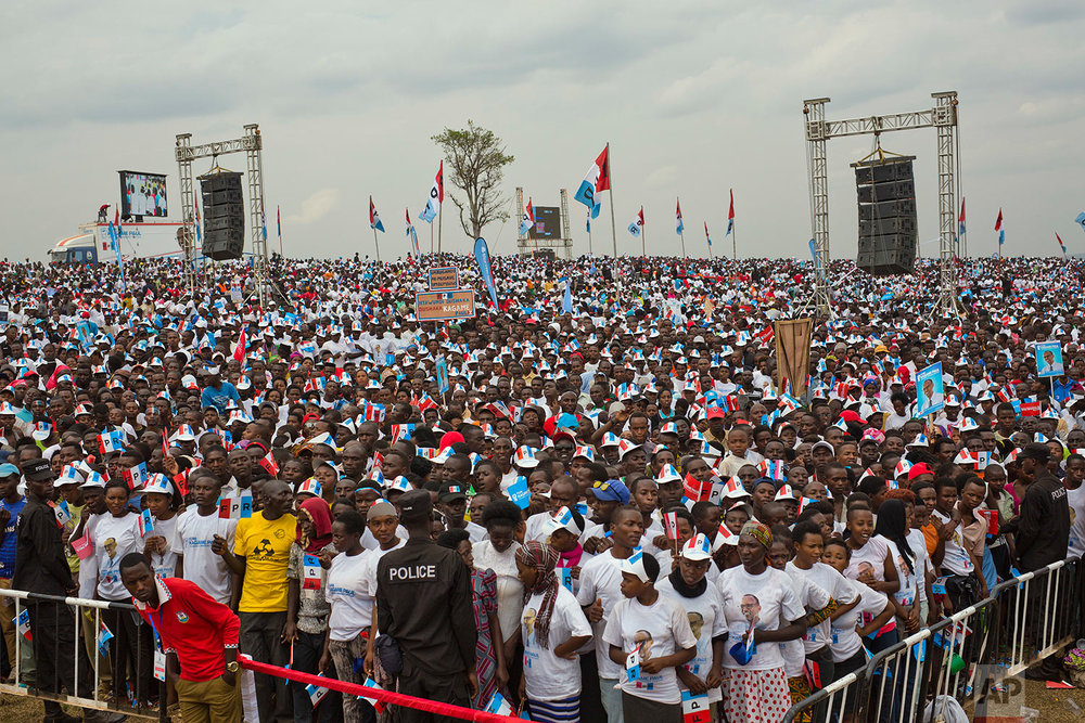 Supporters of Rwanda's President Paul Kagame, center, attend an election campaign rally on the hills overlooking Kigali, Rwanda, Wednesday Aug. 2, 2017. Kagame has been in power since the end of the country's genocide in 1994 and is widely expected to win another term in the Aug. 4 elections after the government earlier this month disqualified all but three candidates. (AP Photo/Jerome Delay)
