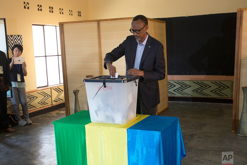 Rwandans President Paul Kagame casts his ballot in Rwanda's capital Kigali Friday Aug. 4, 2017 for the presidential elections in which he is widely expected to win another term after the government disqualified all but three candidates. (AP Photo/Jerome Delay)