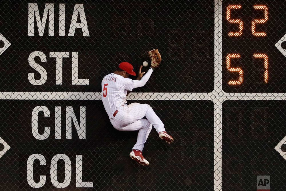 Philadelphia Phillies left fielder Nick Williams cannot catch an RBI triple by Pittsburgh Pirates' Josh Bell during the fourth inning of a baseball game, Wednesday, July 5, 2017, in Philadelphia. (AP Photo/Matt Slocum)