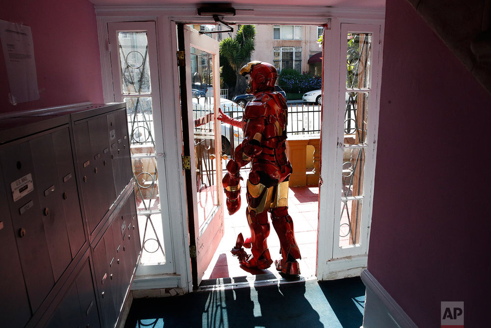 "In this Sunday, June 4, 2017 photo, wearing a $5,000 Iron Man costume, actor Paul Louis Harrell leaves his apartment building, in the Hollywood section of Los Angeles. ""I'm successful because I have the best costume on the block and it's the most expensive one on the block,"" said Harrell. Longtime street performers like Harrell have concerns. They say business used to be more lucrative until the boulevard became overpopulated with costumed characters. What's worse, some look grungy, while others turn off tourists with aggressive demands for money. (AP Photo/Jae C. Hong)"