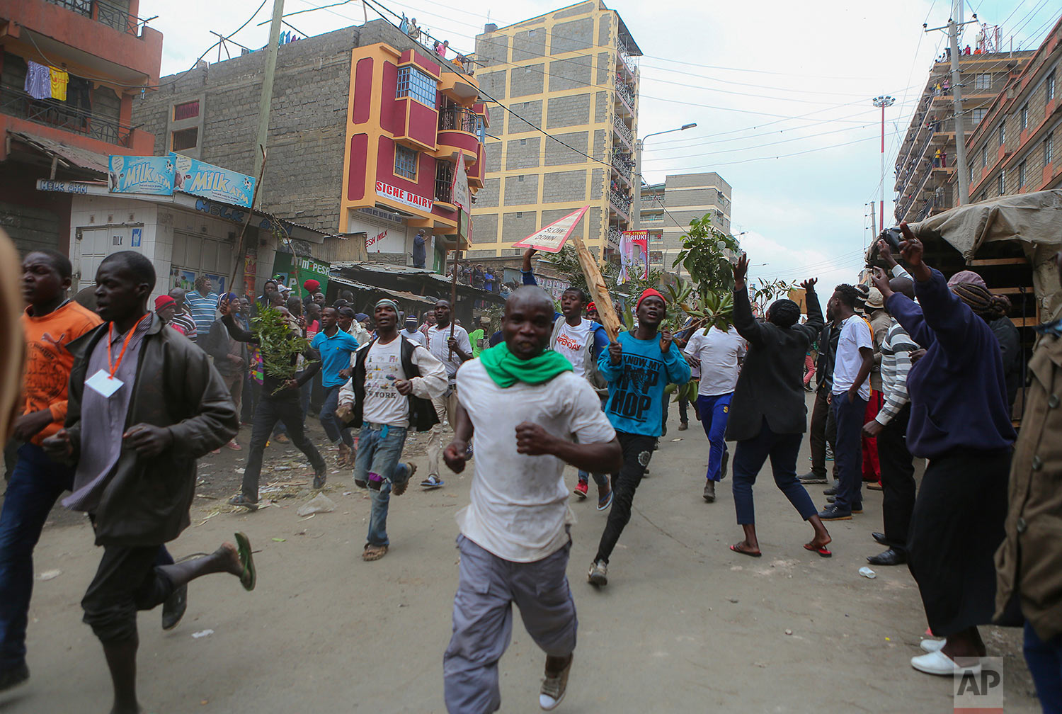 Residents of the Mathare area of Nairobi, Kenya, take to the streets by blocking roads with burning tyres to protest in support of Kenyan opposition leader and presidential candidate Raila Odinga, Wednesday, Aug. 9, 2017. Odinga alleges that hackers manipulated the Tuesday election results which appear to show President Uhuru Kenyatta has a wide lead over Odinga. (AP Photo. (AP Photo/Brian Inganga)