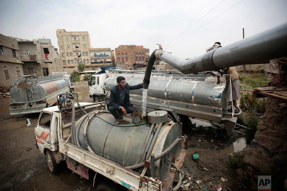 In this photo taken on Wednesday, July 26, 2017, a man fills a tank lorry with water from a water-tap in Sanaa, Yemen. (AP Photo/Hani Mohammed)