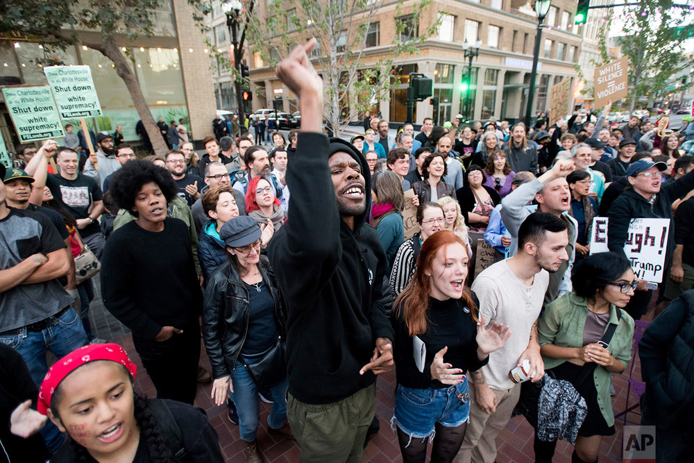 Takoda Patterson, center, protests against racism in Oakland, Calif., Saturday, Aug. 12, 2017. (AP Photo/Noah Berger)