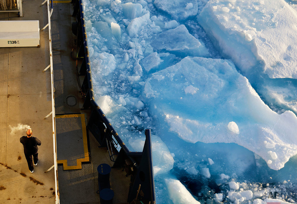Sea ice breaks apart by the passing of the Finnish icebreaker MSV Nordica as it traverses the Northwest Passage through the Victoria Strait in the Canadian Arctic Archipelago Friday, July 21, 2017. Scientists believe there is no way to reverse the decline in Arctic sea ice in the foreseeable future. Even in the best-case scenario envisaged by the 2015 Paris climate accord, sea ice will largely vanish from the Arctic during the summer within the coming decades. (AP Photo/David Goldman)